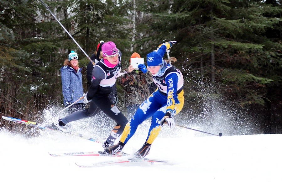 Heidi Widmer (l) and Andrea Dupont after colliding at a NorAm sprint last January in Thunder Bay, Ontario. Widmer suffered a mild concussion, but qualified for the U23 World Championships as a discretionary pick and was fully recovered in five days. Photo: John Sims. faster skier.com