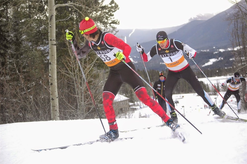 Biathlon Canada's Scott Perras glances back at Michael Somppi (AWCA/NST-Dev.) while leading the men's 20 k freestyle mass start on Sunday at the Canmore Nordic Centre in Canmore, Alberta. Photo: Angus Cockney