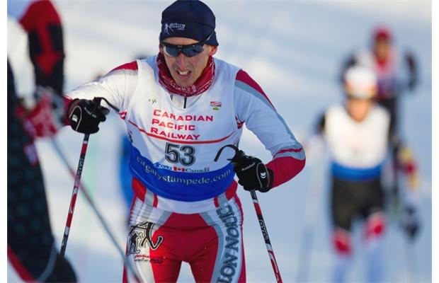 Jeff Holmes of the Foothills Nordic Ski Club rushes up a hill during the Master Men 3-4 10km Alberta Cup race held at the Strathcona Wilderness Centre on Dec 20, 2014. Photograph by: Topher Seguin