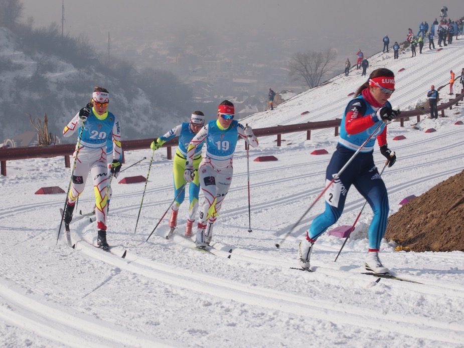 Canadian National Junior Team members Katherine Stewart-Jones (19) and Maya MacIsaac-Jones (29) chase Russia's Natalia Nepryaeva (2) in the quarterfinal of the 1.3 k classic sprint on the opening day of 2015 Junior World Championships in Almaty, Kazakhstan. Photo: Lisa Patterson CCC