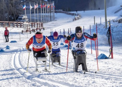Three women sitskiers uphill_pamdoyle w